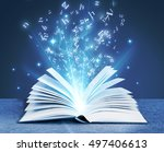 letters flying out of the book | Shutterstock . vector #497406613