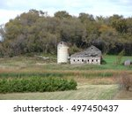 Old Barn And Silo In The...