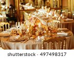 white candles stand among pink... | Shutterstock . vector #497498317