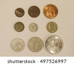 Small photo of Pre-decimal GBP British Pounds coins - farthing (quarter of 1d), half-penny, penny, three-pence, six-pence, shilling (1s), two shillings (2s), half-crown (2/6), coronation crown (5/-)