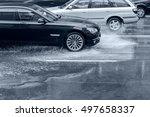car driving on wet road with... | Shutterstock . vector #497658337