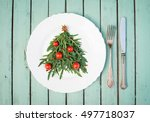 christmas tree made of arugula... | Shutterstock . vector #497718037