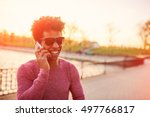 happy afro man talking on the... | Shutterstock . vector #497766817
