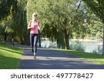 shot of a beautiful fit runner... | Shutterstock . vector #497778427
