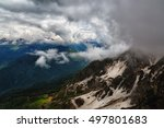 Small photo of Big clouds over the snow-capped mountain peaks,Caucasus