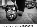 muscular woman holding old and... | Shutterstock . vector #497856997