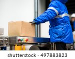 package boxes from conveyor... | Shutterstock . vector #497883823