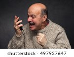 older man yells into the phone... | Shutterstock . vector #497927647