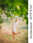 girl in dress on the summer road | Shutterstock . vector #497975767
