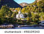 White Stave Church In Small...
