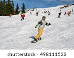 girl on a snowboard down on the ... | Shutterstock . vector #498111523
