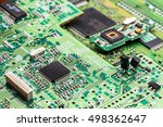 Small photo of Electronic circuit, microchip on green board
