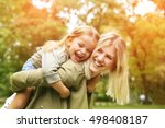 cute young daughter on a piggy... | Shutterstock . vector #498408187