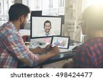 coworkers doing a video... | Shutterstock . vector #498424477