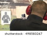 Shooting With A Pistol. Man...