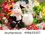 Toy Cow And A Milk Jug On A...
