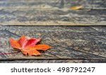 Autumn Red Maple Leaf On Woode...