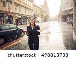woman stands under the rain... | Shutterstock . vector #498813733
