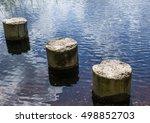 Three Concrete Pillars By The...
