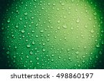 Green Glass With Water Drops...