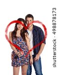 Small photo of Portrait of a young beautiful couple drawing a heart with aerosol can. Isolated white background.