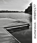 Small photo of black and white photo of wooden pier on Alum Lake 'Kamencove jezero' in Chomutov city at the end of the summer tourist season