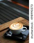Hot Latte Art Served On Wooden...