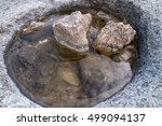 puddle filled with rocks after... | Shutterstock . vector #499094137