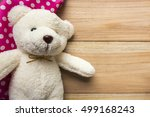 Small photo of hankie and teddy bear on wood backgrounds. top view