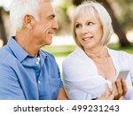 happy senior couple looking at... | Shutterstock . vector #499231243