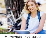 young woman using tablet in the ... | Shutterstock . vector #499233883