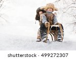two boys sledding with mountain ... | Shutterstock . vector #499272307