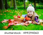 happy girl having a picnic in... | Shutterstock . vector #499294063