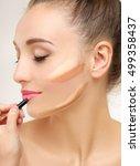 putting makeup .contouring.make ...   Shutterstock . vector #499358437