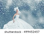 snow winter young woman in long ... | Shutterstock . vector #499452457