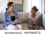 young girl talking with... | Shutterstock . vector #499584073