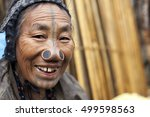 Small photo of ZIRO, ARUNACHAL PRADESH/INDIA - DECEMBER 13, 2013: Woman of the Apatani tribe, with nose plugs, The Apatani are a tribal group of people living in the Ziro valley in Arunachal Pradesh, India.