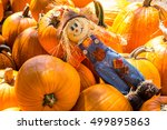 A Scarecrow Lays On Pile Of...