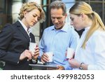 coworkers talking outdoors | Shutterstock . vector #499982053