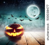 halloween pumpkin in a dark... | Shutterstock . vector #500038477