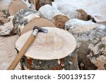 Axe On A Chunk Of Firewood In...