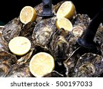 oysters and lemons in a pile. | Shutterstock . vector #500197033
