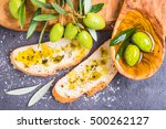 Small photo of Olive oil and olives, bread.Testing fresh mediterranean extra virgin olive oil.