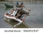 Small photo of traditional fishing boat capsize into the sea .filtered image.selective focus
