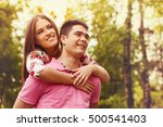 a couple relaxing in the nature. | Shutterstock . vector #500541403