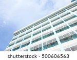 Condominium Building With Blue...
