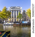 Small photo of Amsterdam, Holland, october, 2014: Visitors in front of the Felix Merites conference center building on the Keizersgracht canal, home of the annual Amsterdam Dance Event (ADE)