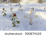 grave with red roses in snow at ... | Shutterstock . vector #500874103