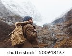 Man With Backpack Trekking In...