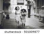 two beautiful girls walking city | Shutterstock . vector #501009877